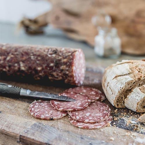 cut venison salami and bread
