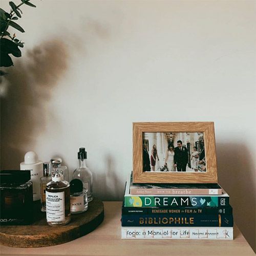 a pile of books and a wedding picture in jen carrington's home