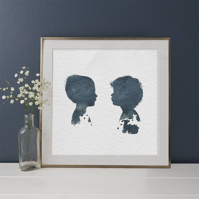 silhouette portraits of two kids