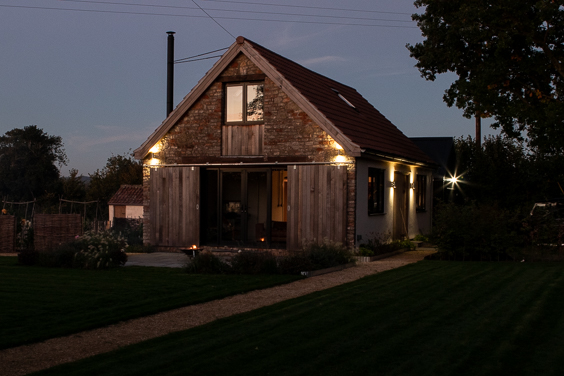 oak tree barn at night
