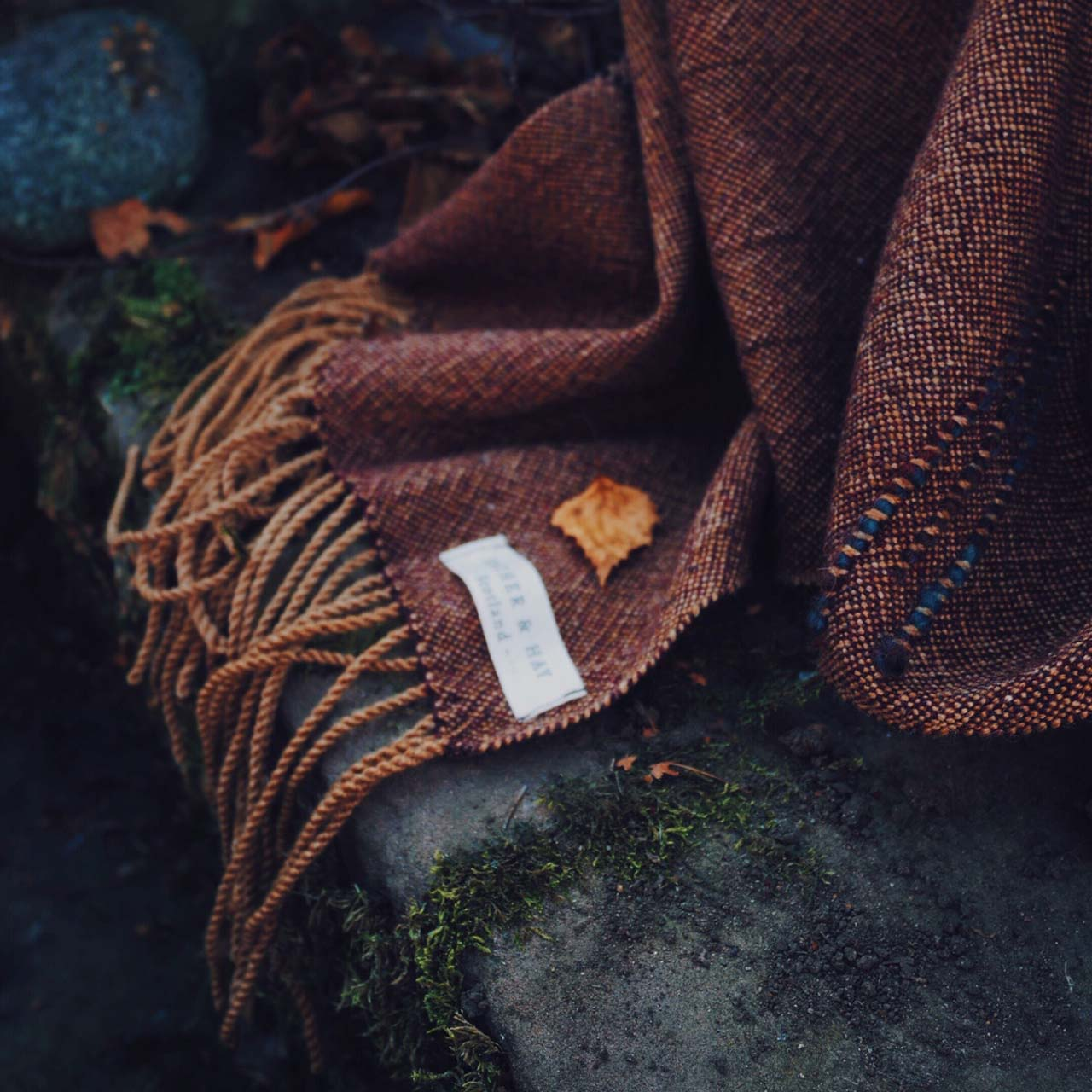 a shawl lying on a stone stairway in autumn