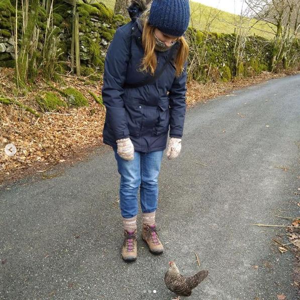 Lynnen Davies-Craine admiring a bird during a walk