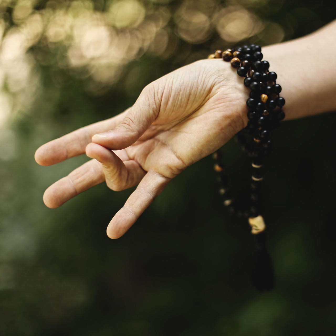 a woman's hand in zen yoga position - lifestyle services
