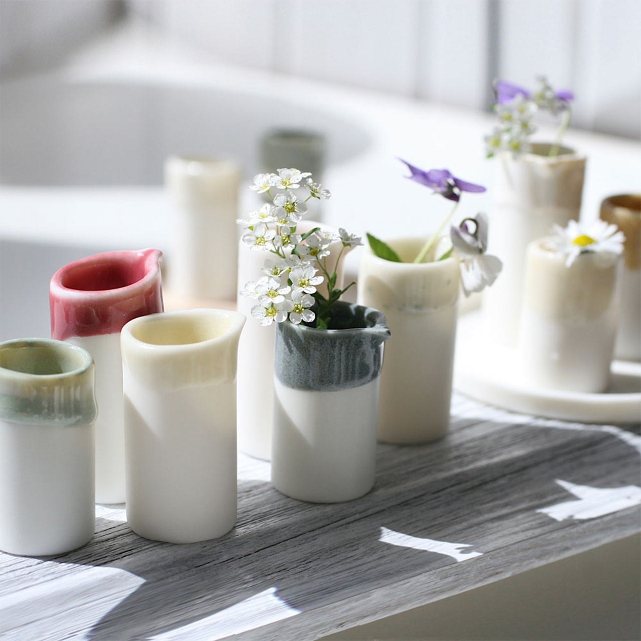 set of miniature vases from naked clay ceramics