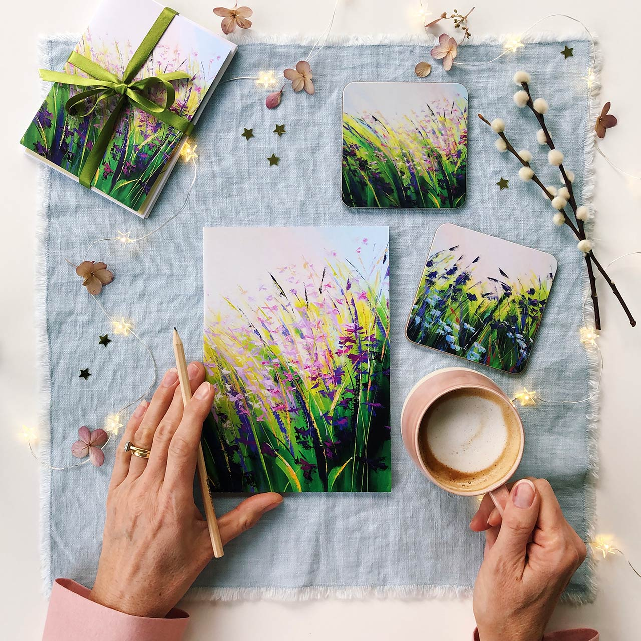 flatlay of gifting items with Sue Rapley Art paintings