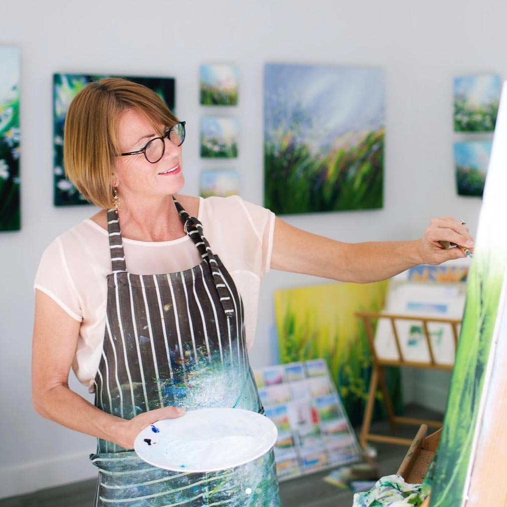 Sue Rapley working on one of her paintings in her studio